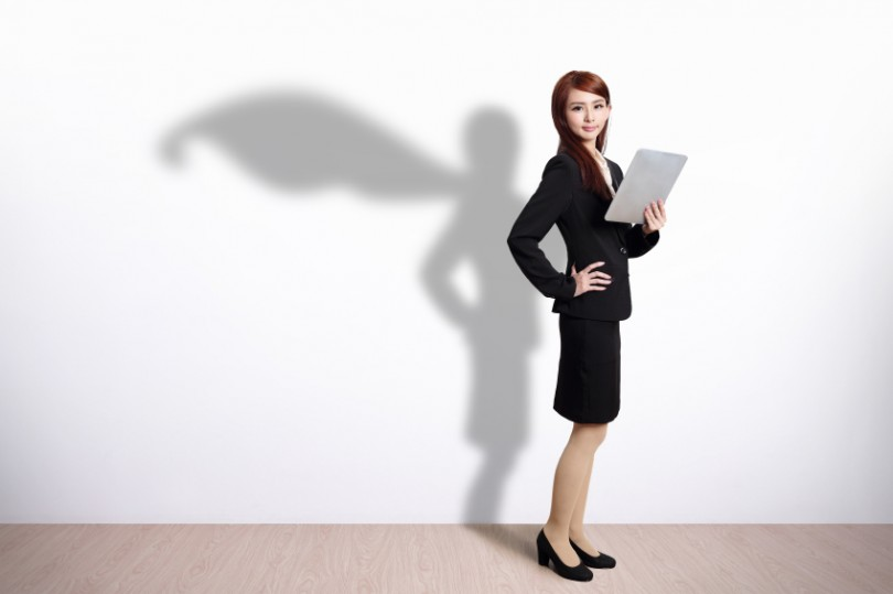 Superhero Business Woman using digital tablet pc computer with white wall background, great for your design or text, asian